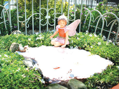 Fairy garden features figure