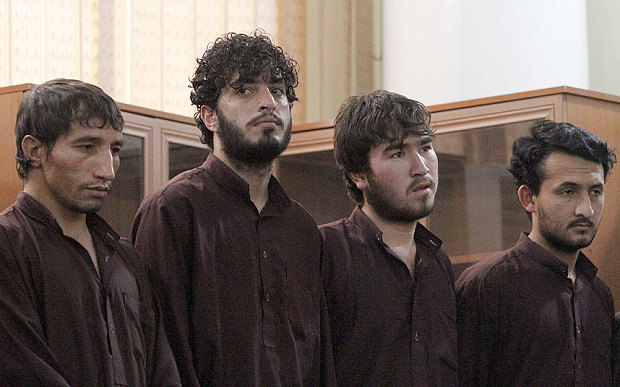 Defendants attend a hearing in the case of a 27-year-old Afghan woman named Farkhunda who was beaten to death in Kabul Photo: AP