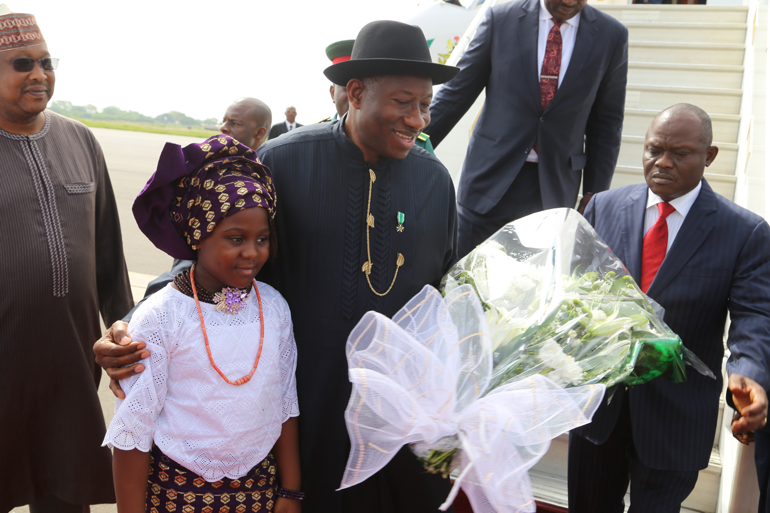 President Goodluck Jonathan and little Bola  on his arrival at Ghana airport to attend the 47th Ordinary Session of the Ecowas Authority of Heads of State and Government