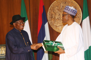 Jonathan giving the handover notes to Buhari
