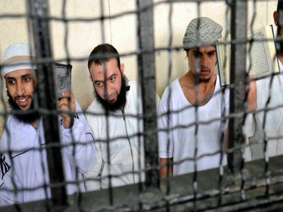 Eight of the 14 Egyptians sentenced to death in absentia. Photo by Reuters