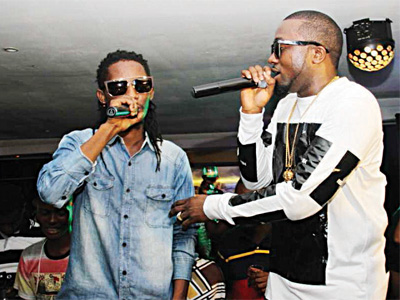 Jesse Jagz and Ice Prince performing at an event