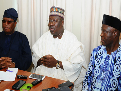 Segun Babatope (left); Senator Aminu Lawan and Roy Jibromah at the Media Interactive Session with Political Editors in Lagos…yesterday