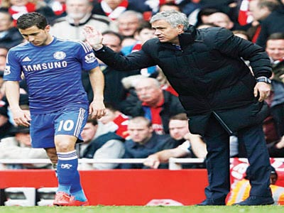 Chelsea Manager, Jose Mourinho (right) and Eden Hazard, who has been voted the best player in the English Premiership.  PHOTO: AFP.