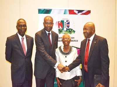 Deputy president, Nigerian-British Chamber of Commerce (NBCC), Prince Dapo Adelegan (left); President, Nigerian Stock Exchange (NSE), Aigboje Aig-Imoukhuede; Past President, NBCC, Mrs. Adetutu Adeleke; and President, Prince Adeyemi Adefulu, at the NBCC's Breakfast Meeting, in Lagos