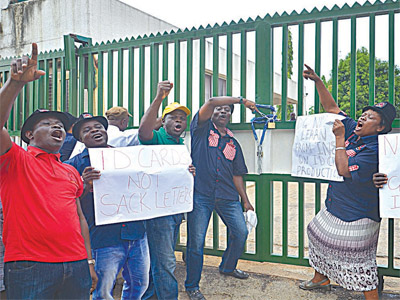 Some members of staff of National Identity Management Commission (NIMC) protesting lack of welfare and the commission's plan to sack over 1,000 workers in Abuja… yesterday.					                 PHOTO: LADIDI LUCY ELUKPO