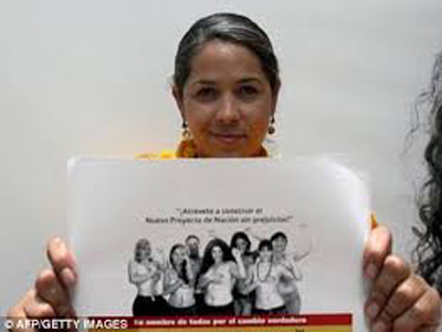 Natalie Juarez holding a copy of the topless ad