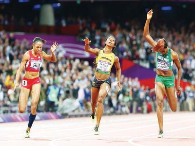 Allyson Felix (left), Blessing Okagbare and Shelly-Ann Fraser-Pryce during the final of the London Olympics' 100 metres race. PHOTO: AFP.