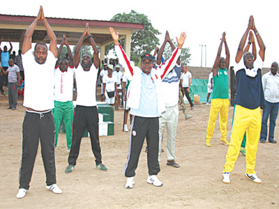General Olawunmi exercising with NYSC members