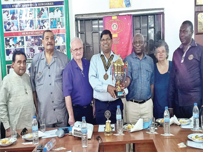 Patel (left), Dr. Thomopulous, Silvers, Biswal, Omotosho, Susan and Olaye as Omotosho presents the winners trophy to Biswal during Silvers visit.