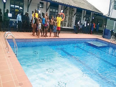 pupils of st saviours school ebute metta waiting to dive into the schools - Olympic Swimming Pool 2015