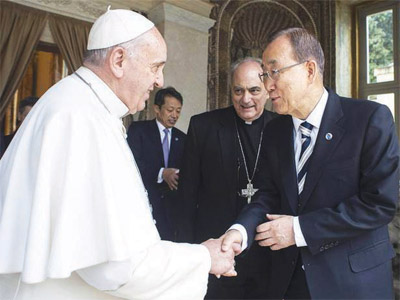 United Nations Secretary-General, Ban Ki-Moon in a hand shake with Pope Francis during the climate summit in the Vatican, recently