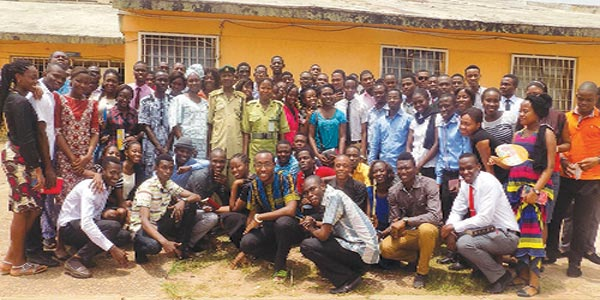 Members of CMDAS (UNIBEN) and (IUO) pose with officials of Oko Prison in Benin.