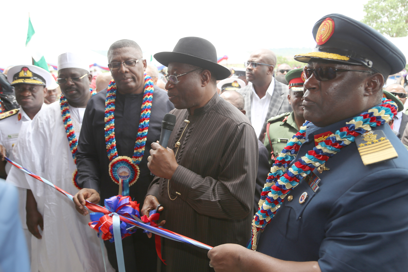 Defence Minister of state Col Augustine Akobundu President Goodluck Jonathan and the Chief of Defence Staff air Marshal Alex Badeh Presenting a gift at the   Commission of the Nigerian Army Radio Station at the Mogadishu Barrack in Abuja yesterday