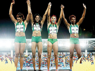 Nigeria's Blessing Okagbare (left), Regina George, Dominique Duncan and Christy Udoh after winning the women's 4 x 200 metres at the International Association of Athletics Federations (IAAF) World Relays in Nassau, Bahamas...yesterday.                 PHOTO: AFP