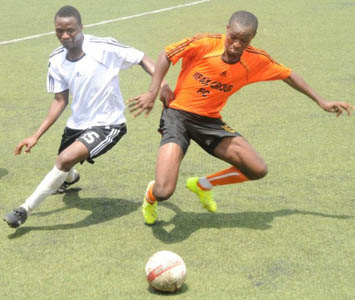 Samuel Babujayi of Nigeria Customs Service (left), contesting the ball with Itodo Christian of Sifax Group during the quarter final match of the 6th Ships & Ports Maritime Cup at the National Stadium, Surulere, Lagos