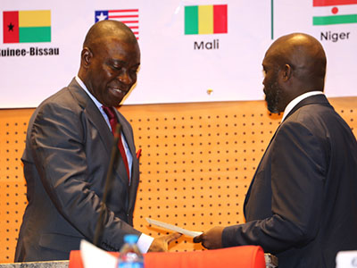 Former World Footballer of the Year and Member of the Liberian National Assembly, Senator George Weah presents his Oath of Office to the Speaker of the ECOWAS, Senator Ike Ekweremadu after the Liberian was sworn in as a Member of the ECOWAS Parliament in Abuja on Monday. PHOTO: OFFICE OF THE DSP