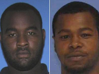Two arrested in Mississippi after policemen shot dead