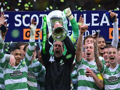 Ronny Deila won his first trophy as Celtic manager as the Hoops beat 10-man Dundee United 2-0 in the Scottish League Cup final. PHOTO: talksport.com