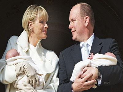 Princess Charlene and Prince Albert smile at each other as they show their twins. Photo: dailymail