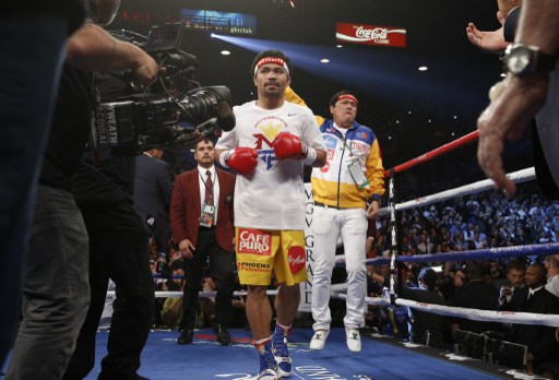 Manny Pacquiao enters the ring for his welterweight unification fight against Floyd Mayweather Jr., on May 2, 2015 at the MGM Grand Garden Arena in Las Vegas, Nevada. AFP PHOTO / JOHN GURZINKSI