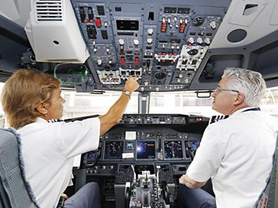 Pilots discussing technical issues on board an aircraft