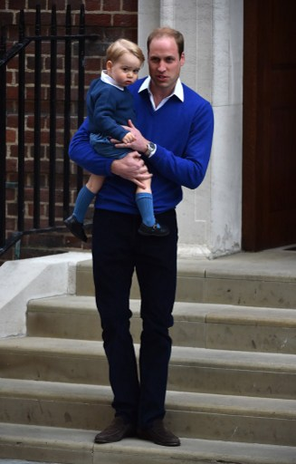 Britain's Prince William, Duke of Cambridge (R), stands with his son Prince George of Cambridge as they return to the Lindo Wing at St Mary's Hospital in central London, on May 2, 2015 where his wife Catherine, Duchess of Cambridge, gave birth to their second child, a baby girl, earlier in the day. The Duchess of Cambridge was safely delivered of a daughter weighing 8lbs 3oz, Kensington Palace announced. The newly-born Princess of Cambridge is fourth in line to the British throne. AFP PHOTO / BEN STANSALL
