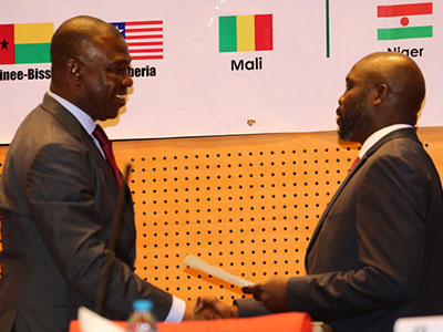 Speaker of the ECOWAS Parliament, Senator Ike Ekweremadu (left) congratulates former World Footballer of the Year and Member of the Liberian Parliament, Senator George Weah after the Liberian was sworn in as a Member of the Community Parliament in Abuja on Monday. PHOTO: OFFICE OF THE DSP