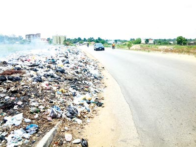 Mountain of refuse (left) and an untidy intersection in Makurdi