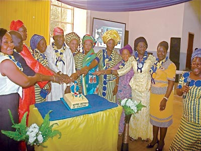 cross-section of Women in Colleges of Education (WICE) cutting a cake at the event.   PHOTOS: CHARLES OKOLO