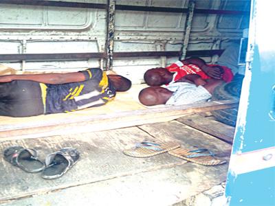 Suspected miscreants sleeping inside an abandoned vehicle