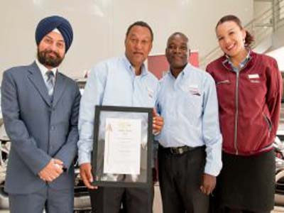 Action Auto team (from left to right) Guringer Singh, Finance, Jimmy Dons, Workshop, Joseph Felemenga, Parts and Lilia Samui, Vehicles Sales, proudly display their hard earned PMR Golden Arrow Award for Leaders and Achievers in Motor Vehicle Dealerships in Zambia PHOTO: media.gm.com/