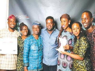 Kelani (third left), Kunle Afolayan, Lola Akindoju and Nollywoodweek crew after dazzling Mirrage was named winner of the Audience Choice Award