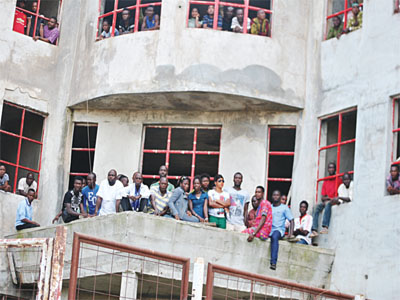 Sunshine Stars' supporters watching their team's game against Kano Pillars from an uncompleted building near the stadium.