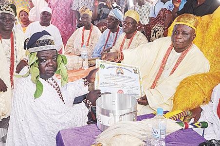 Prince Abiodun Ogunbo, CEO, Ashela Properties Limited, receiving Chieftaincy Certificate as Apesinola from Oba Tajudeen Afolabi Elemoro, Onitedo of Okeodo and Iwerekun land after his installation in Lagos... at the weekend.