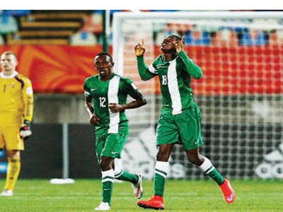 lying Eagles' Taiwo Awoniyi (right) celebrates his second goal against Hungary during their last group game yesterday at the on-going FIFA U*-20 World Cup. Nigeria will now meet Germany in the second round of the competition. PHOTO: FIFA.COM