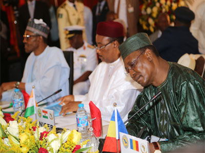 From left President Mohammadu Buhari Niger Republic President Mahamadou Issoufou and  Chadian President Idriss Deby at the Opening Ceremony of the Summit of Heads of state and Govt, of the Chad Basin Commission at the Nnamdi Azikiway International Airport Abuja Today,11 june 2015 from Philip Ojisua