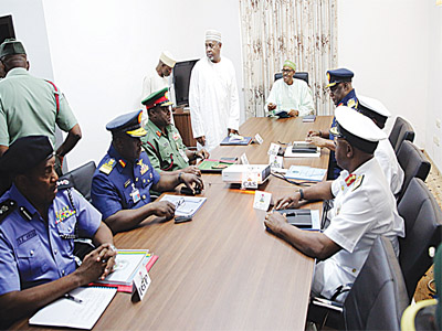 President Muhammadu Buhari and Service Chiefs at a meeting at Defence House in Abuja yesterday. Service Chiefs in attendance were Chief of Defence Staff, Air Chief Marshal Alex Badeh; Chief of Army Staff, Lt-General Kenneth T. J. Minimah; Chief of Air Staff, Air Marshal A. N. Amosun; Chief of Naval Staff, Vice Admiral U. O. Jibrin and Inspector General of Police, Solomon Arase.