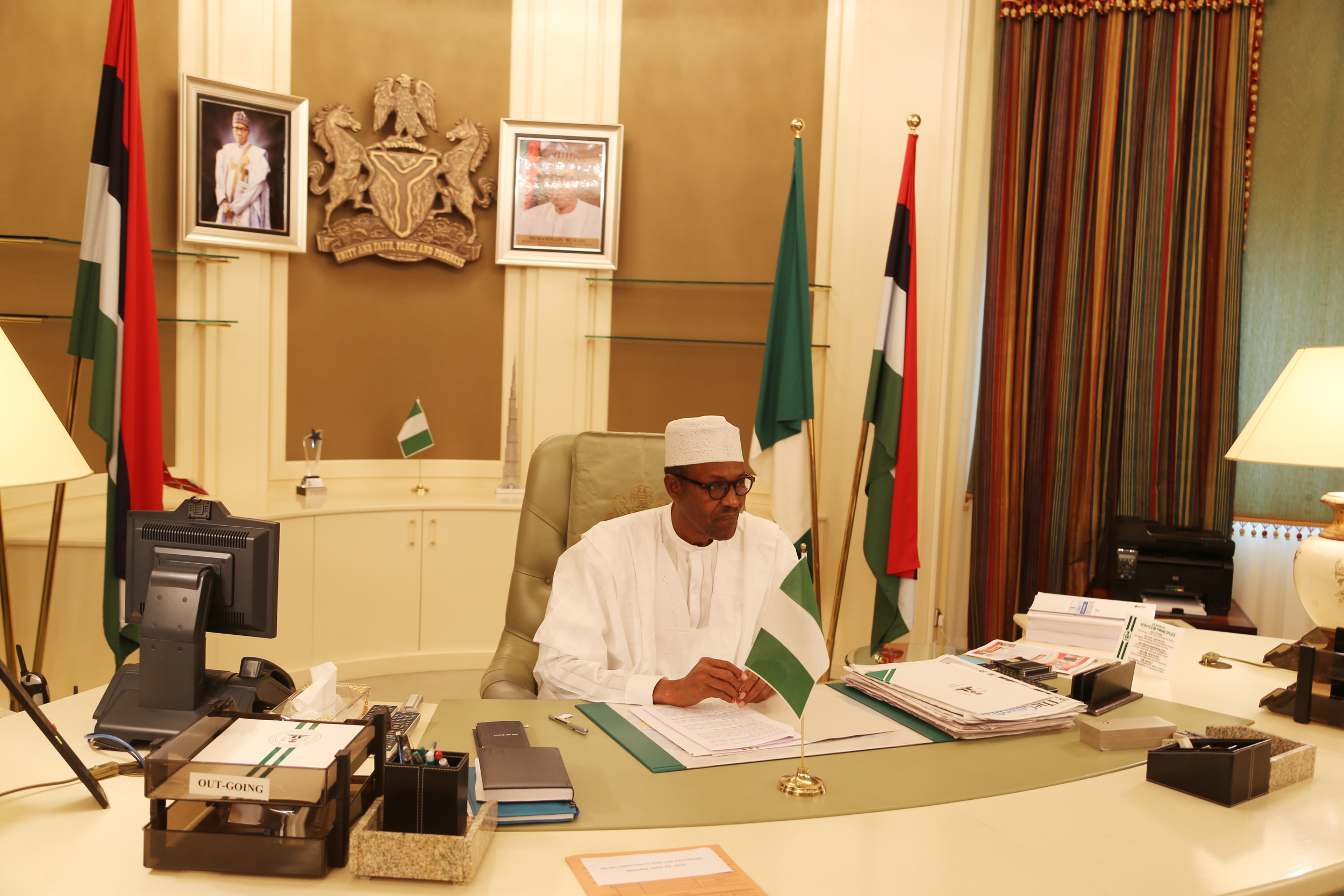 photos president buhari resumes in his office at aso villa