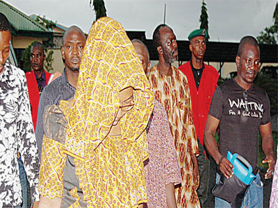 Some of the suspected CBN officials and others on arrival for arraignment at a Federal High Court in Ibadan on Tuesday by the EFCC over their involvement in the over N80billion currency fraud.                  PHOTO: NAJEEM RAHEEM