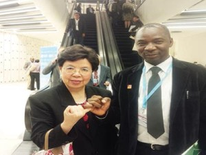 Director General of the World Health Organisation (WHO), Dr. Margaret Chan (left) and Executive Director of National Primary Health Care Development Agency (NPHCDA), Dr. Ado Gana Muhammad,  joining hands against polio at the just concluded World Health Assembly in Geneva, Switzerland