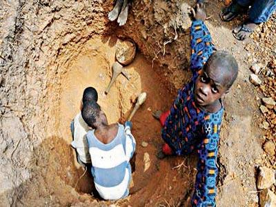Under aged children digging well