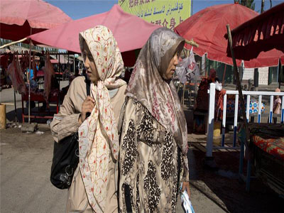 Uighur rights groups say China's restrictions on Islam in Xinjiang have added to violent ethnic tensions in the region [AP]