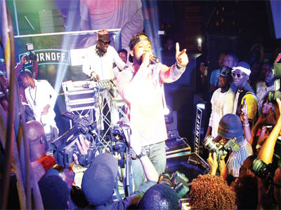 DJ Spinall on the Wheel of Steel, as Iyanya performs at Industry Nite in Lagos