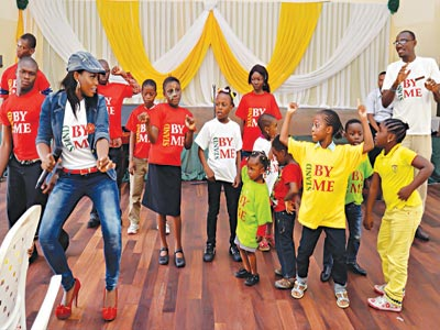Debbie performing with the kids at Shuga's inauguration trail