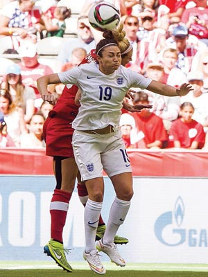 England's Jodie Taylor and Lauren Sesselmann of Canada battle for the ball during their quarterfinal…on Saturday.                   PHOTO: AFP