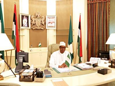 First Day inside Aso villa Office President Muhammadu Buhari in his office at Aso Rock Villa, Abuja …yesterday                                                 PHOTO: PHILIP OJISUA
