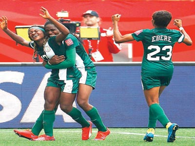Super Falcons celebrating a goal against Sweden during their opening game of the on-going Canada 2015 FIFA Women World Cup.              PHOTO: AFP