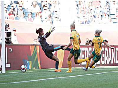 Kyah Simon of Australia (right) beats Super Falcons' Precious Dede to score one of Australia's goals in their 2-0 defeat of Nigeria…on Friday.        PHOTO: FIFA