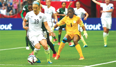 USA's Julie Johnston (left) shields the ball from Super Falcons' Goalkeeper, Precious Dede, during their final group game at the on-going FIFA Women World Cup in Canada. Faustina Phillips-Oare says Nigeria will only begin to achieve the desired result when players are selected on merit. Inset Faustina Phillips-Oare.                       PHOTO: FIFA